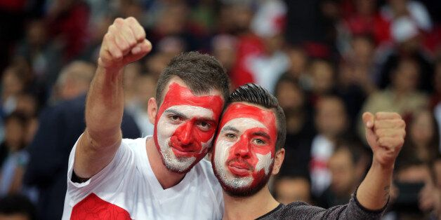 Soccer fans of Turkey's react before their Euro 2016 Group A qualifying match between Turkey and Iceland...