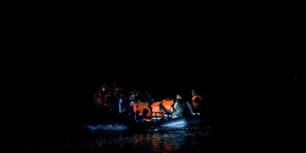 Syrian refugees arrive on the shores of the Greek island of Lesbos after crossing the Aegean sea on a...