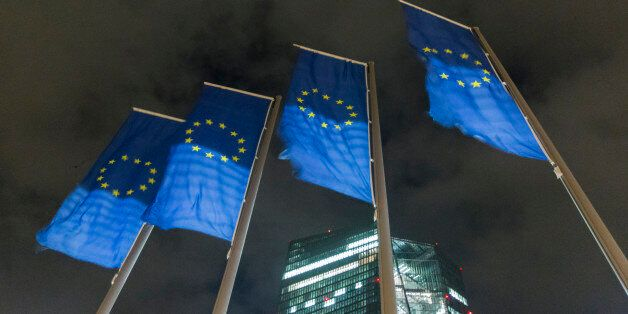 The stars of the European Union (EU) sit on banners flying outside the European Central Bank (ECB) headquarters,...