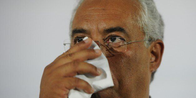 Socialist Party's leader Antonio Costa gestures as he addresses his supporters after loosing the general...
