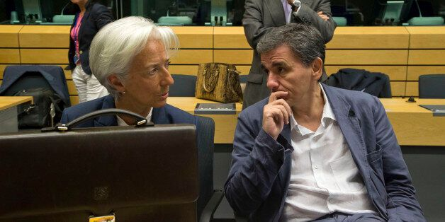 Greek Finance Minister Euclid Tsakalotos, right, speaks with Managing Director of the International Monetary...