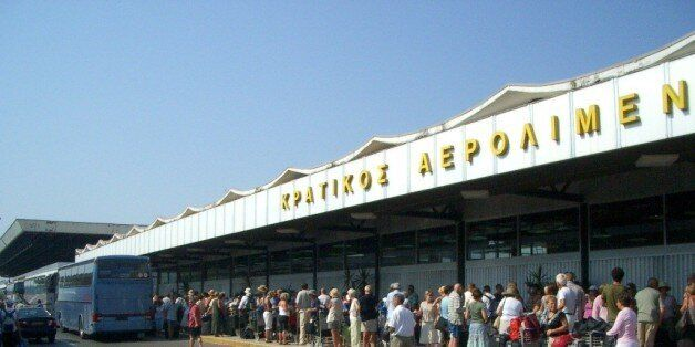Aaaaaagh! Hyuge queue in 40 degree heat outside the (full) airport terminal building in Corfu. NOT