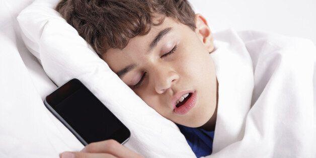 Sleeping with his smart phone