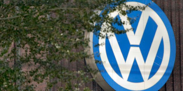 Trees stand in front of giant logo of the German car manufacturer Volkswagen in Wolfsburg, Germany, Saturday,...