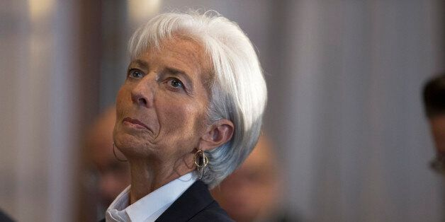 International Monetary Find (IMF) Managing Director Christine Lagarde listens as she is introduced prior...