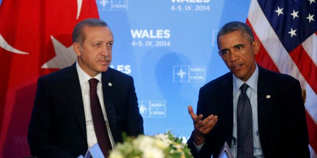 President Barack Obama speaks to reporters as he meets with Turkish President Recep Tayyip Erdogan at...
