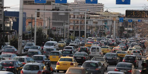 Drivers use their cars during a 24-hour strike by public transport in Athens, Thursday, Jan. 13, 2011....