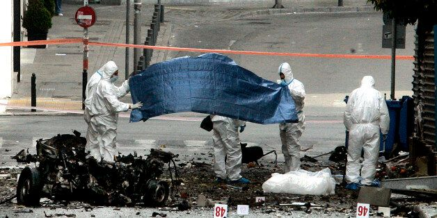 ATHENS, GREECE - APRIL 10: Forensic police examine the scene after a car bomb explosion in central Athens...