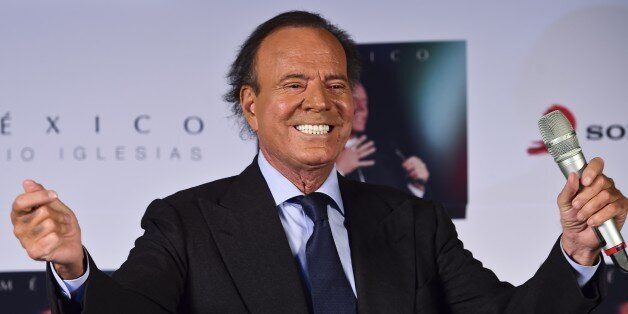 Spanish singer Julio Iglesias gestures during a press conference in Mexico city, on September 23, 2015....