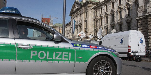 MUNICH, GERMANY - MARCH 11: A police car is pictured in front of the justice palace court house where...