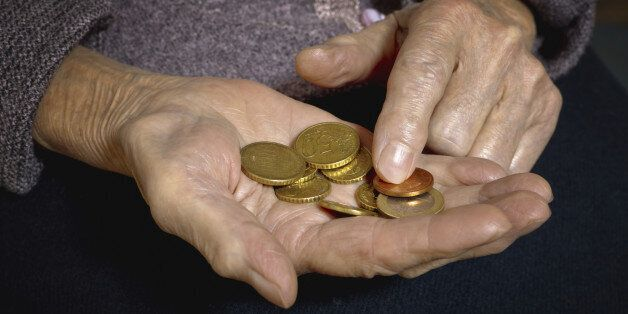 Euro coins in old woman's hands. Bussines