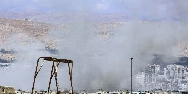 DAMASCUS, SYRIA - OCTOBER 08: Smoke rises after the Assad regime forces airstirkes on Jobar district...