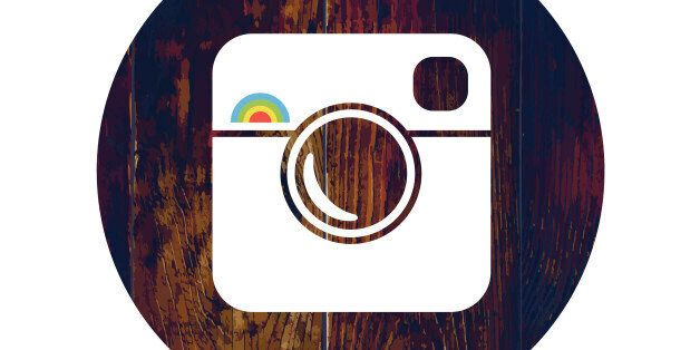 Hipster Photo Icon on Wooden Texture with Cross Process