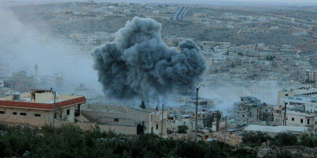 ALEPPO, SYRIA - OCTOBER 13: Smoke rises after Russian war crafts hit the Syrian opposition controlled...