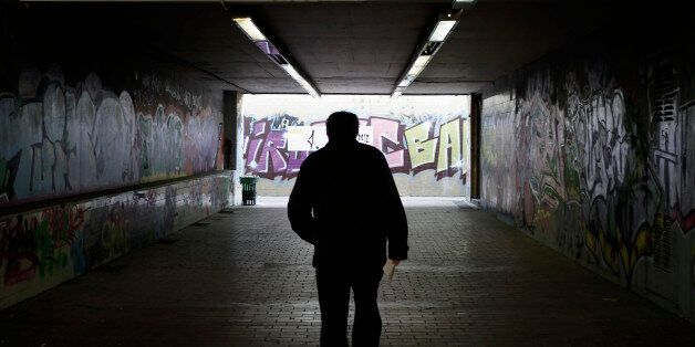 A man walks at an underground pedestrian crossing, in Athens, on Thursday, Nov. 15, 2012. Greece's economy...