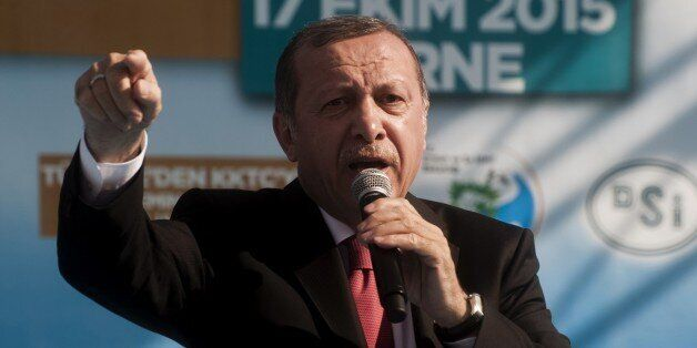 Turkish President Recep Tayyip Erdogan gestures as he delivers a speech during the inauguration ceremony...