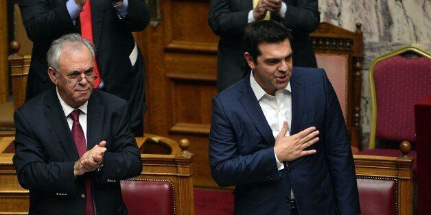 Greek prime minister Alexis Tsipras (R) acknowledges the applauds, after his speech prior to a confidence...