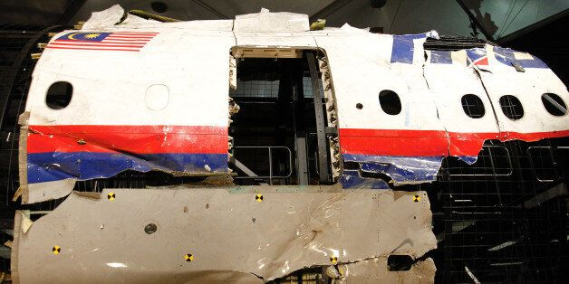 GILZE-RIJEN AIR BASE, Oct. 13, 2015 -- Wreckage of flight MH17 is seen after the presentation of the...