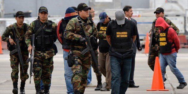 Mexican detainees Ruben Larios Dug (front) and Josef Gutiérrez Leon (2nd), members of the Sinaloa cartel,...