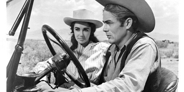 Elizabeth Taylor and James Dean in car together in a scene from the film 'Giant', 1956. (Photo by Warner...