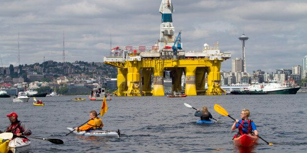 SEATTLE, WA - MAY 14: Environmental activists in kayaks protest the arrival of the Polar Pioneer, an...