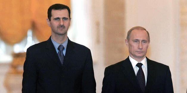 MOSCOW, RUSSIAN FEDERATION: Russian President Vladimir Putin (C-R), his wife Lyudmila (L), Syrian President...