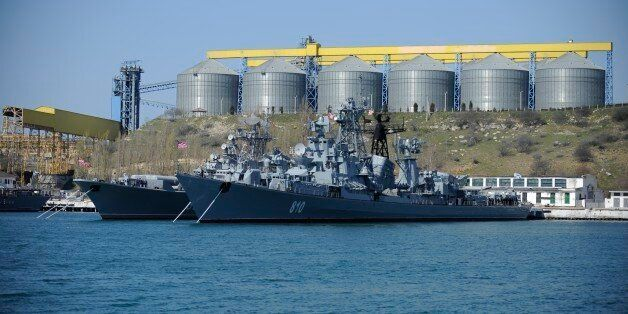 FILE - In this Monday, March 31, 2014 file photo Russian Black Sea fleet ships are anchored in one of...