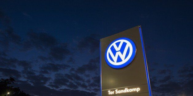 A logo of German car manufacturing giant Volkswagen is seen outside their headquarters in Wolfsburg on...