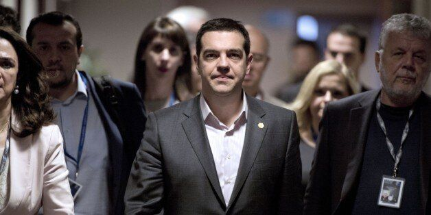 Greek Prime Minister Alexis Tsipras arrives for a press conference on March 20, 2015 at the end of a...