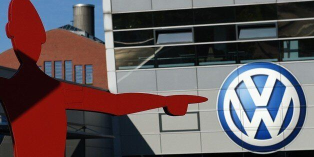 The logo of German car maker Volkswagen (VW) is seen at the entrance to a VW branch in Duesseldorf, western...
