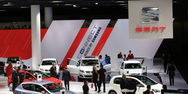 Visitors look at Seat automobiles, produced by Volkswagen AG, during the IAA Frankfurt Motor Show in...