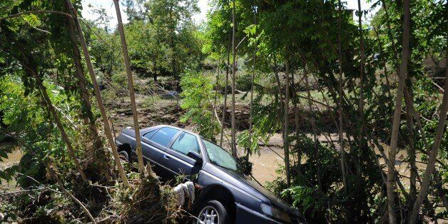 A picture shows a car washed away by floods in the village of Gammal in the French department of Gard...