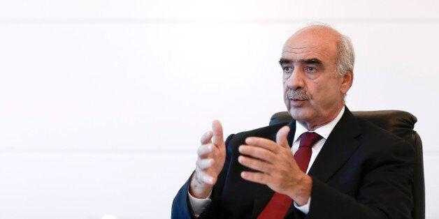 Evangelos-Vassilios Meimarakis, leader of the New Democracy Party of Greece, gestures whilst speaking...