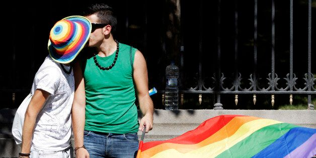 A couple kiss each other during the EuroPride parade in Madrid, Saturday, June 30, 2007. Spain, predominantly...