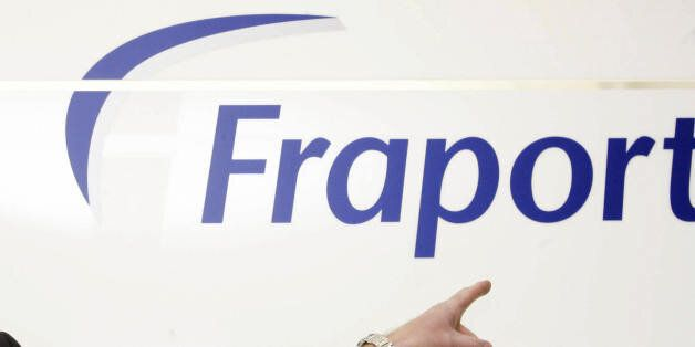 FRANKFURT/MAIN, GERMANY: Fraport chairman Wilhelm Bender poses in front of his company's logo prior to...