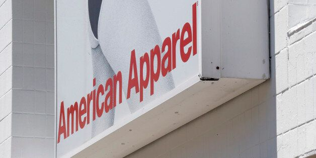 This July 9, 2015 photo shows signage at the American Apparel store in the Shadyside neighborhood of Pittsburgh. (AP Photo/Keith Srakocic)