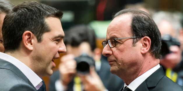 French President Francois Hollande, right, speaks with Greek Prime Minister Alexis Tsipras during a round...