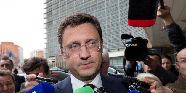 Russia's Energy Minister Alexander Novak, center, speaks with the media as he arrives in front of EU...