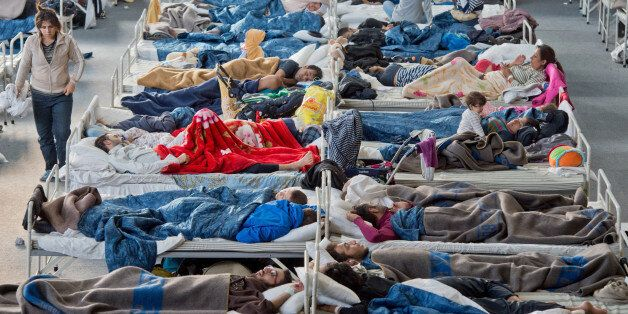 Migrants rest in a shelter in Hanau, central Germany, Thursday Sept. 24, 2015. Around 700 refugees mostly...