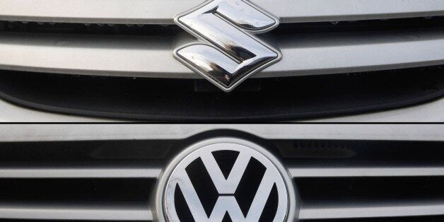 This combo of photos shows a Volkswagen and a Suzuki logo on cars at a car dealership in the northern...