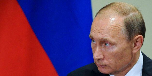 Russian President President Vladimir Putin listens to United Nations Secretary-General Ban Ki-moon after...