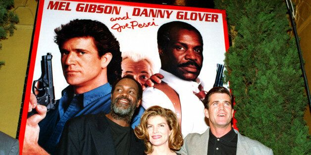Co-stars Danny Glover, left, Rene Russo, center, and Mel Gibson pose in front of