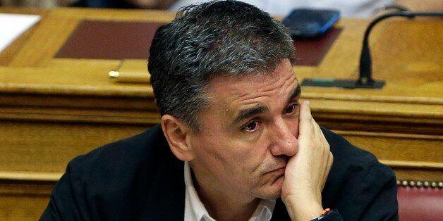 Greek Finance Minister Euclid Tsakalotos attends an emergency parliament session at the Greek Parliament...