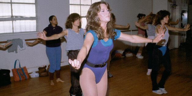 Jane Fonda jogs in place as she joins an early morning exercise class  at her Jane Fonda Workout Studio in Beverly Hills, Calif., December 15, 1983.   She joined in on the exercises to put to rest recent rumors that she had been suffering from heart problems.   (AP Photo/Reed Saxon)