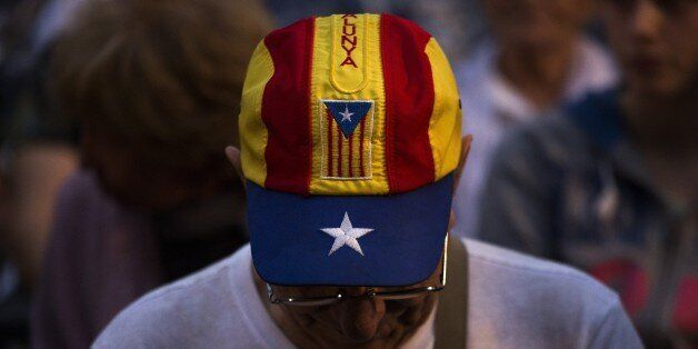 In this Wednesday, Sept. 23, 2015 photo, a pro independence supporter attends a rally