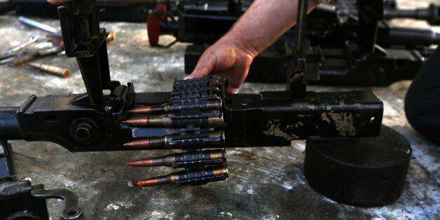 Iraqi Kurdish, Hama Sour works at his workshop where he repairs all types of weapons for Kurdish Peshmerga...