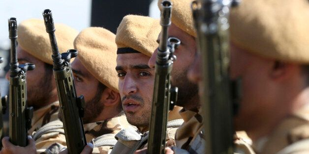 Iranian army troops conclude their march in a military parade marking the 35th anniversary of Iraq's...