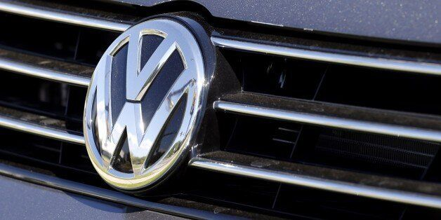 The grille of a Volkswagen car for sale is decorated with the iconic company symbol at a VW dealership...