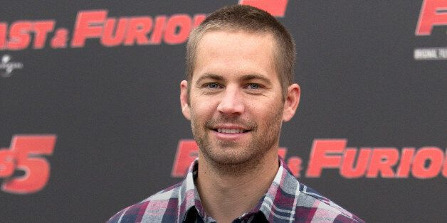 FILE - In this April 29, 2011 file photo, actor Paul Walker poses during the photo call of the