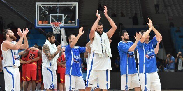(From L) Greece's power forward Kostas Kaimakoglou, Greece's power forward Georgios Printezis, Greece's...